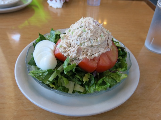 Very refreshing meal - a giant tomato with tuna and red onion